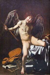 Caravaggio, amor zwycięski, amor vincit omnia. Amor, chłopiec ze skrzydłami w pozie stojącej